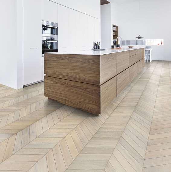 Kahrs oak chevron white engineered wood flooring for Chevron laminate flooring